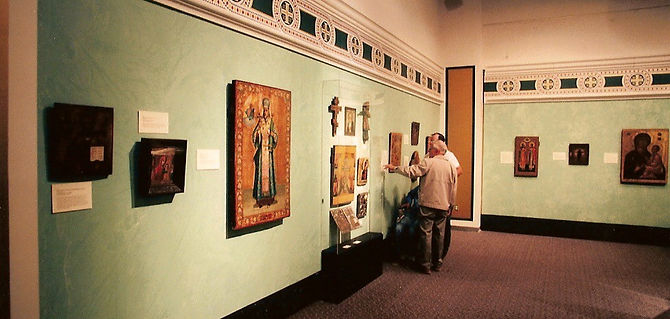 museum visitors looking at traveling exhibits