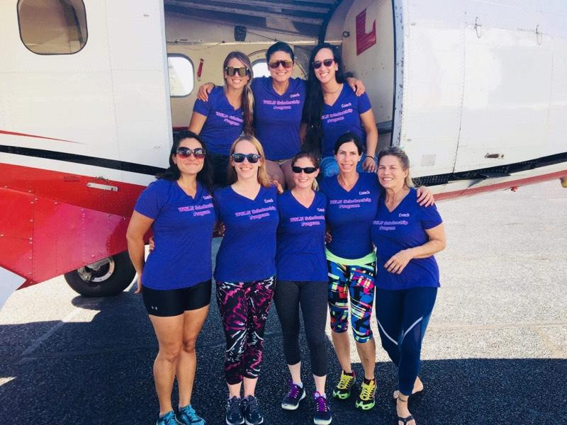 Women skydivers pose for picture WSLN