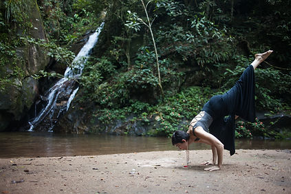 eka pada bakasana by the waterfall
