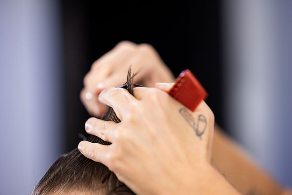 Two Hands Cutting hair