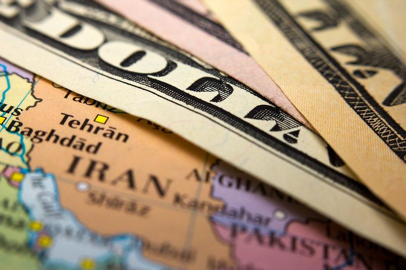 Dollar bills on top of a map of Iran.jpg