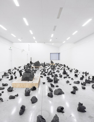 (Exhibition view)   3000 kilo's of clay and three multiplex plinths.   3 day performance at M-idzomer Festival, 2018, M Museum, Leuven, Belgium  Picture by Silvia Cappellari
