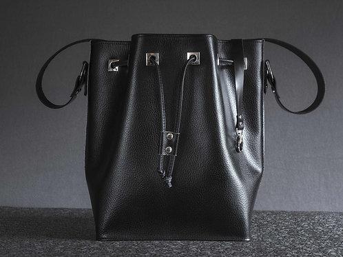 Scharze Handtasche - Platz für 5 Champagnerflaschen