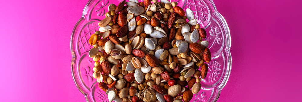 A bowl containing nuts and seeds