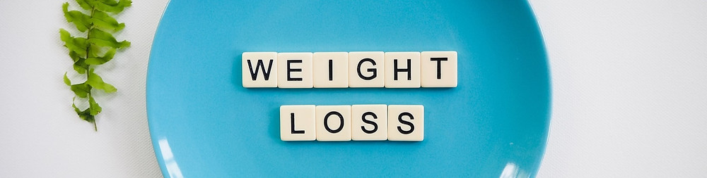 A plate displaying the letters Weight Loss