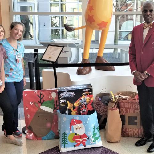 Foundation Chairman, Dr. Stephen Lawrence donates toys to the Bristol Myers Squibb Children's Hospital at Robert Wood Johnson University Hospital Child Life Program.