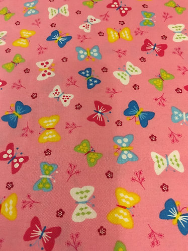Scattered butterflies on pink