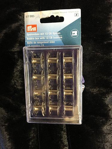 Prym bobbin case including 12 standard size metal bobbins