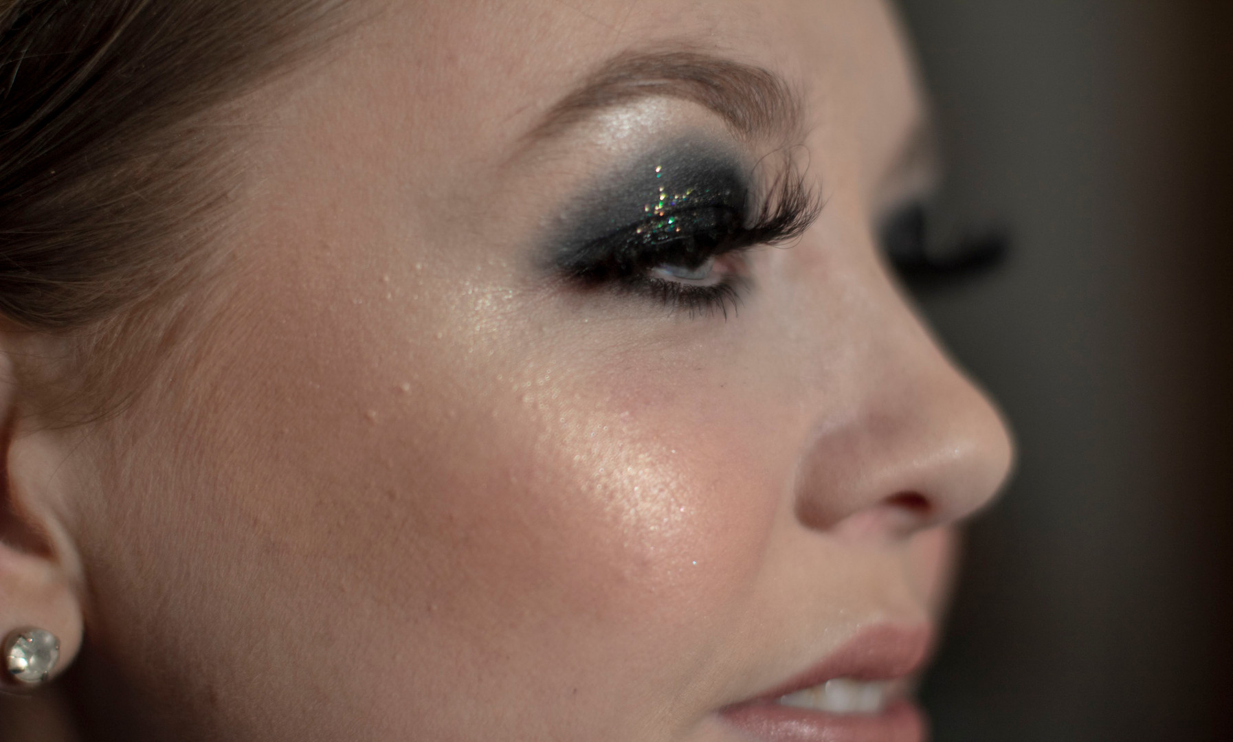 Black smokey eye with glitter party makeup