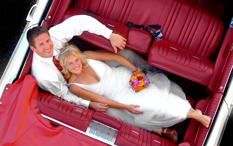 Bridal couple in classic car