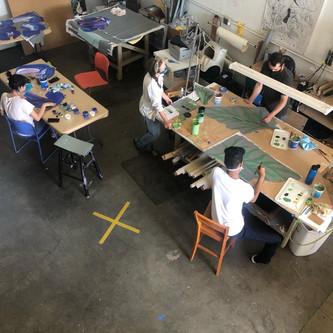 Sky, Alina, Justin, and Vijay paint leaves