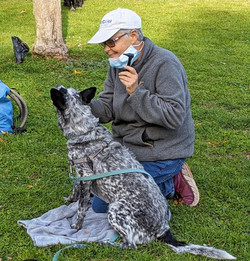 Mardi and Shadow with the otoscope