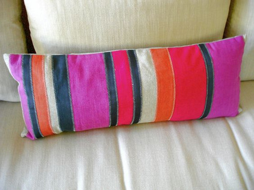 We handstitched each stripe on this colorful lumbar pillow.