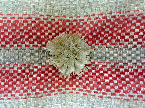 Handcrafted rosette tufts add a charming design element.