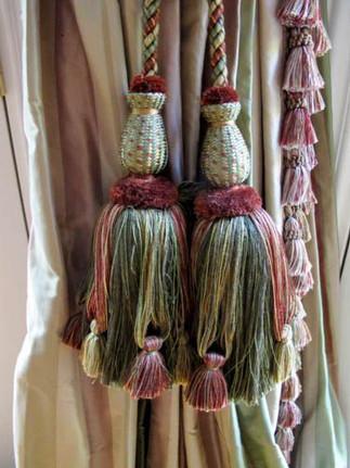 Tassel tie backs and tassel trim on lead edge.