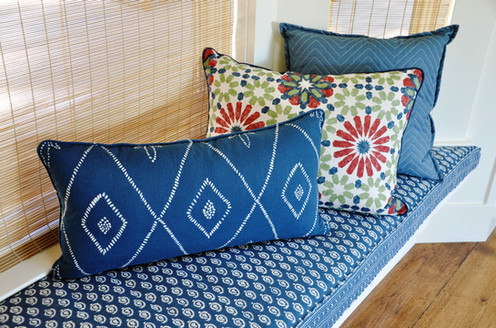 Cheery seat cushion and pillows with self welt, contrast welt, and small flange.