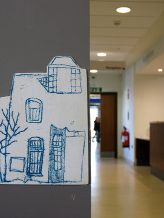 The children's drawings and prints can also be found hidden around the hospital as wooden plaques and vinyl stickers.