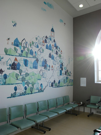 The final installation of digital wallpaper showing a collage of the children's prints and drawings, depicting their ideas of Cossham Hospital as a safe and nurturing environment.