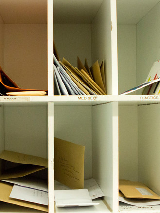 Postcards in staff pigeon holes at UHG's post room / image credit Ruby Wallis