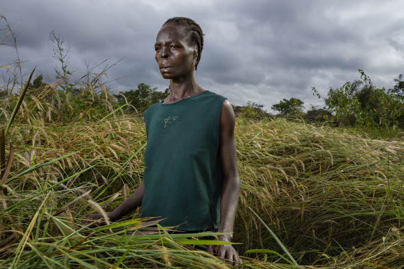 Margaret Acino was 23, pregnant, and working in the fields near Gulu, Uganda, when a commander in Joseph Kony's Lord's Resistance Army called for a razor and ordered his boy soldiers to slice off her lips, ears, and nose. Photograph courtesy of Brent Stirton.