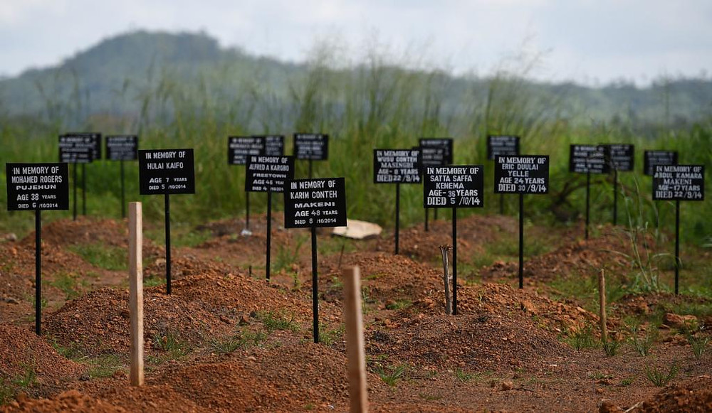 Tombstones are seen on Nov. 15, 2014 at a cemetery at the Kenama Ebola treatment center run by the Red Cross.  FRANCISCO LEONGAFP/Getty Images