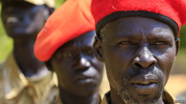 FILE - South Sudanese soldiers listen during a briefing at the army general headquarters in Juba, Jan. 8, 2014.