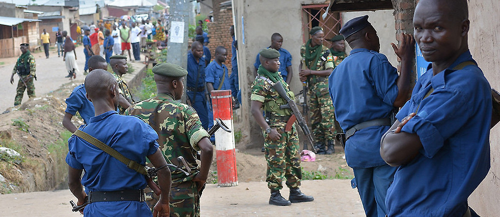 Burundian security forces stand guard following the discovery of several bodies resulting from the country's renewed violence. Bjumubura, Burundi, October 4, 2015. October 4, 2015. (Yvan Rukundo/Anadolu Agency/Getty Images)