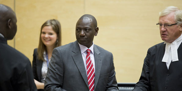 Kenya's Deputy President William Ruto (centre) at the ICC during his trial. Kenya is pushing AU to withdraw from the court. PHOTO   FILE