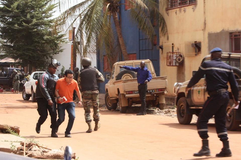 Troopers help a hostage escape a hotel siege in Bamako, Mali