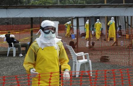 """Medicins Sans Frontieres (MSF) health workers prepare at ELWA""""s isolation camp during the visit of Senior United Nations (U.N.) System Coordinator for Ebola David Nabarro, at the camp in Monrovia August 23, 2014."""