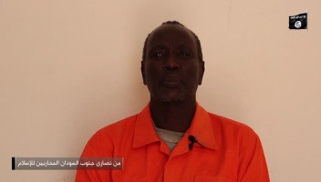 Screenshot from ISIS video showing an unidentified South Sudan man's beheading (ST)