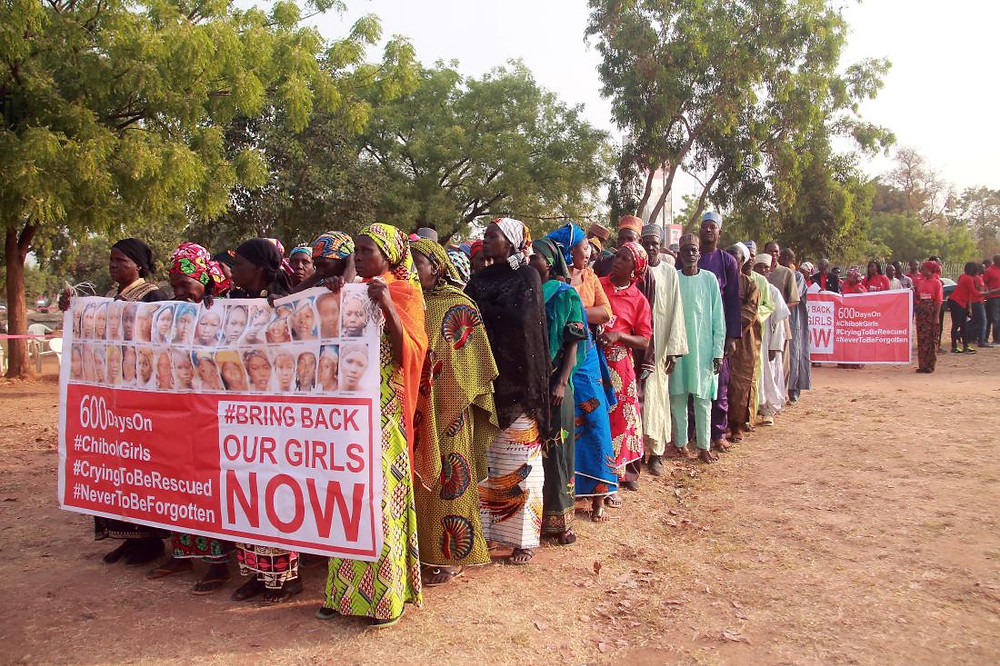 """Members of the """"Bring Back Our Girls"""" movement and mothers of the missing schoolgirls march in Abuja on January 14, 2016."""