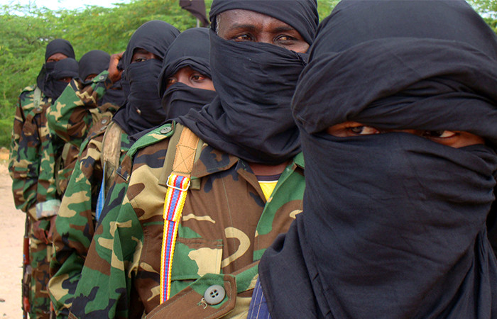 Members of the hard line al Shabaab Islamist rebel group parade during a military training exercise in Huriwaa district, southern Mogadishu. 5 September, 2010. Reuters.