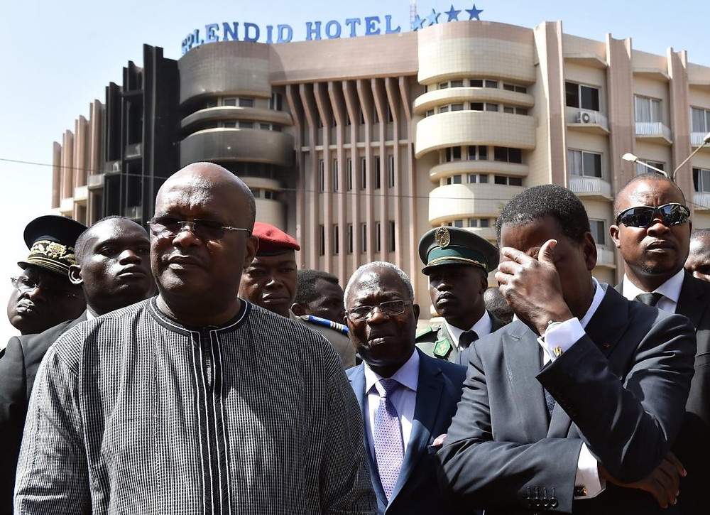 Burkina Faso's President Roch Marc Christian Kabore (left) and Benin's President Thomas Boni Yayi visit the Splendid hotel in Ouagadougou on Jan. 18, 2016.