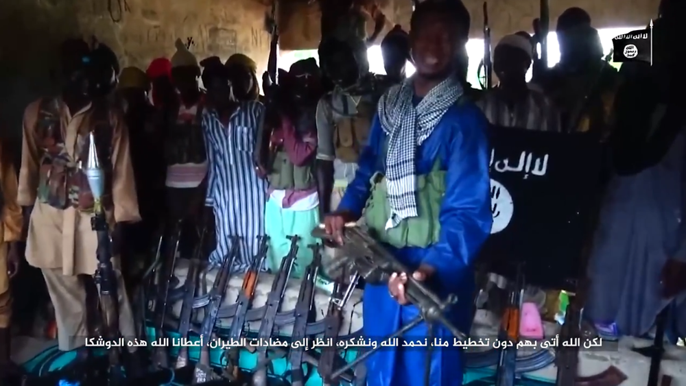 Islamic State West Africa fighter showing off captured weapons in northeastern Nigeria