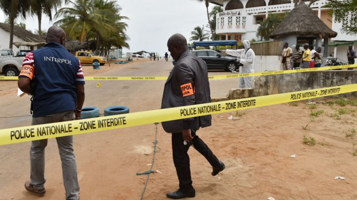 © Issouf Sanogo, AFP | Police officials conduct investigations in Grand Bassam, Ivory Coast, on March 14, 2016, a day after a deadly jihadist attack.