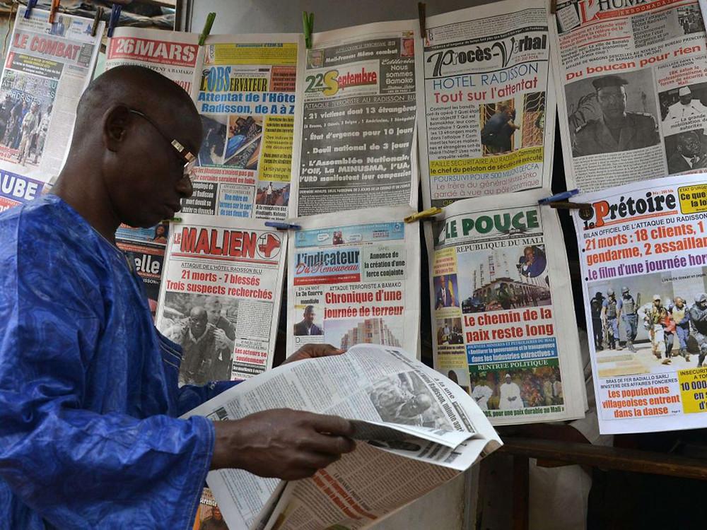 Newspaper headlines in Bamako, Mali, report the bombing at the Radisson Blu hotel last week.Mali's president, Ibrahim Boubacar Keita, blamed the attack on the Macina Liberation Front AFP