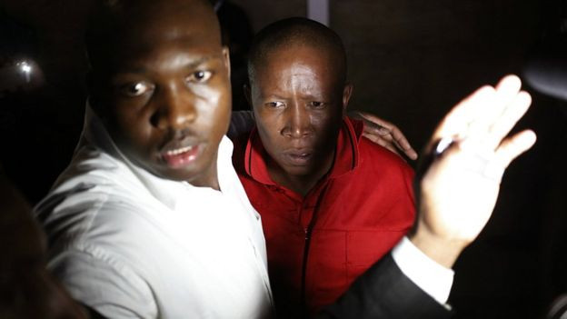 EFF leader Julius Malema, in red, was among those ejected from the chamber