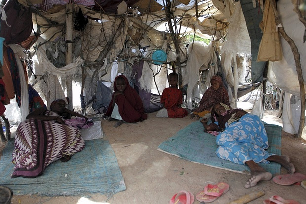 A Somali refugee family inside their makeshift shelter at the Ifo camp in Dadaab. Photograph: Thomas Mukoya/Reuters
