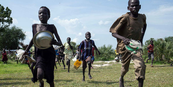 Children race to the drop zone to gather any food or seeds that were spilled during an air drop in Leer, South Sudan, on July 5, 2014. PHOTO | FILE