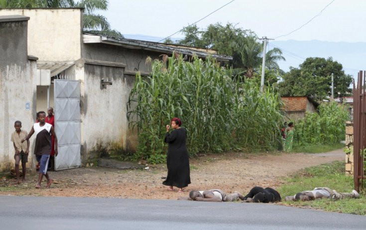 Residents look at the bodies of unidentified men killed during gunfire, in the Nyakabiga neighbourhood of Burundi's capital BujumburaREUTERS/Jean Pierre Aime Harerimana