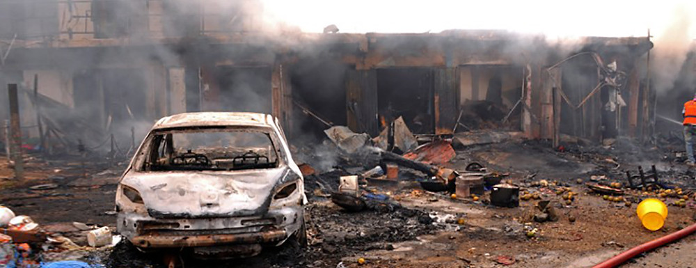 Twin car bombings on Tuesday, May 20, 2014, killed at least 46 in central Nigeria in the latest in a series of deadly blasts that will stoke fears about security despite international help in the fight against militants. (AFP PHOTO / STR)