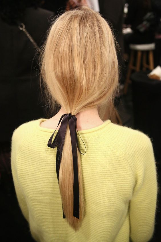 low slung ponytail with black hair bow ribbon - Hair Blog Australia