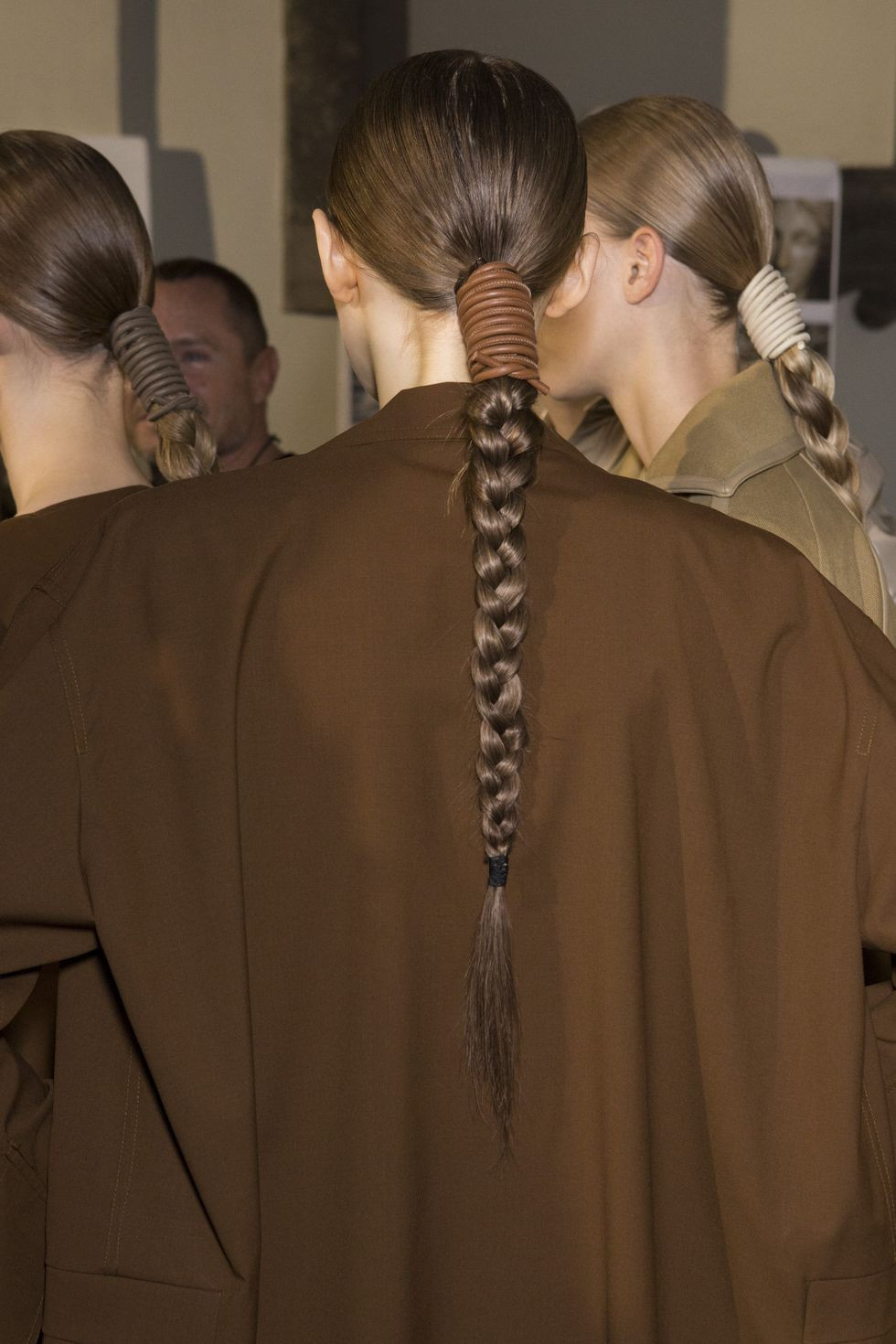 Long braids backstage at Max Mara - Runway Hairstyle Reviews
