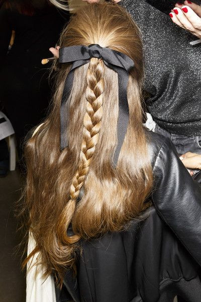 Half up hairstyle with plait and hair bow featured at John Galliano Paris Fashion week