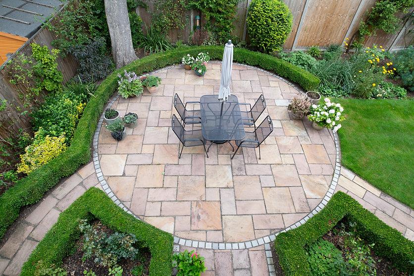 circular garden patio with freshly jet w