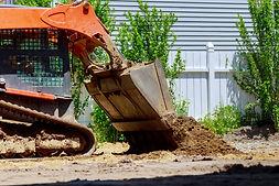 Mini bulldozer with earth doing landscap
