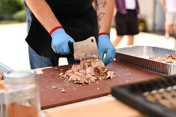 Chef chopping pork
