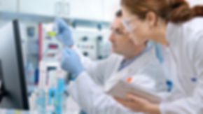 scientists-working-in-lab-full-width-peo