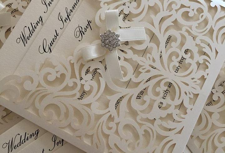 Laser cut wallet wedding invitations